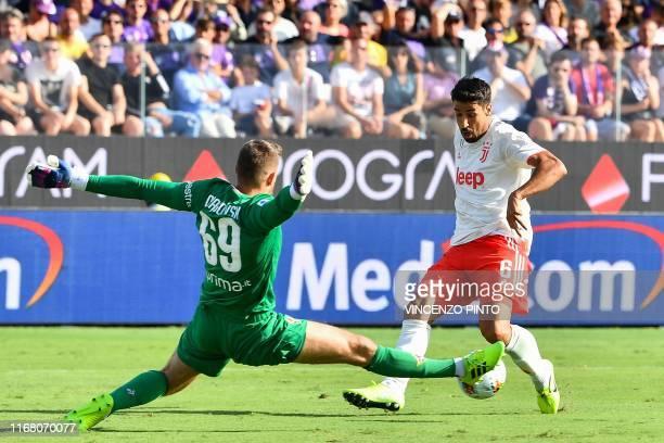 Juventus' German midfielder Sami Khedira challenges Fiorentina's Polish goalkeeper Bartlomiej Dragowski during the Italian Serie A football match...