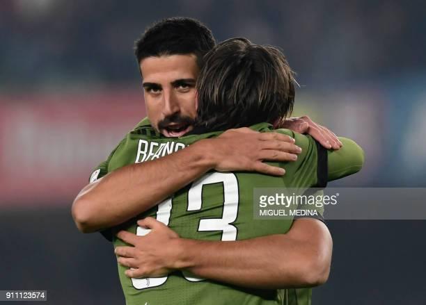 Juventus' German midfielder Sami Khedira is congratulated by Juventus' forward Federico Bernardeschi after scoring during the Italian Serie A...