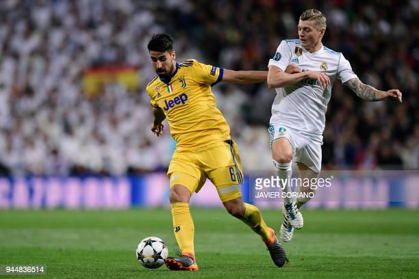 Juventus' German midfielder Sami Khedira vies with Real Madrid's German midfielder Toni Kroos during the UEFA Champions League quarterfinal second...