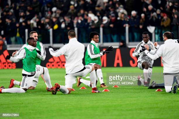 Juventus' Ghanaian midfielder Kwadwo Asamoah Juventus' Argentinian forward Gonzalo Higuain Juventus' Colombian forward Juan Cuadrado and Juventus'...