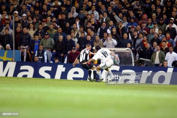 Juventus' Gianluca Pessotto and Real Madrid's Luis Figo battle for the ball