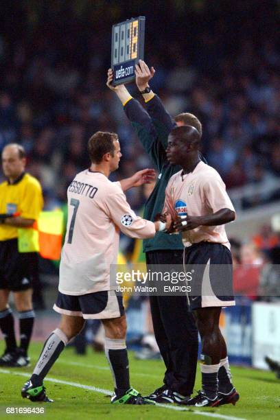 Juventus' Gianluca Pessotto shakes hands with teammate Stephen Appiah as he is substituted