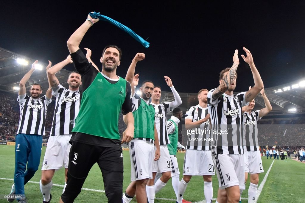 Juventus' goalkeeper from Italy Gianluigi Buffon celebrates with teammates at the end of the Italian Serie A football match AS Roma vs Juventus at the Olympic stadium on May 13, 2018 in Rome. Juventus won a seventh straight Serie A title on Sunday after a goalless draw against ten-man Roma at the Stadio Olimpico. - The Turin giants become the first team to complete the league and Cup double for four consecutive seasons. It is the 34th Scudetto in Juventus's history.