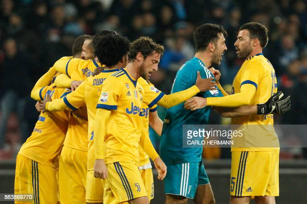 Juventus' goalkeeper from Italy Gianluigi Buffon celebrates with Juventus' defender from Italy Andrea Barzagli at the end of the Italian Serie A...