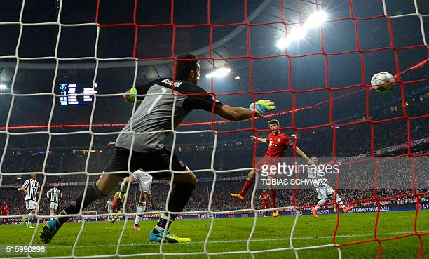 Juventus' goalkeeper from Italy Gianluigi Buffon fails to save a shot from Bayern Munich's midfielder Thomas Mueller during the UEFA Champions League...