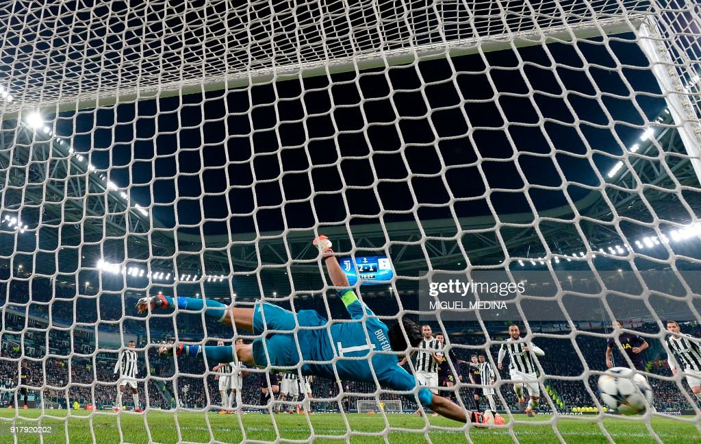 Juventus' goalkeeper from Italy Gianluigi Buffon fails to stop a goal during the UEFA Champions League round of sixteen first leg football match between Juventus and Tottenham Hotspur at The Allianz Stadium in Turin on February 13, 2018. /