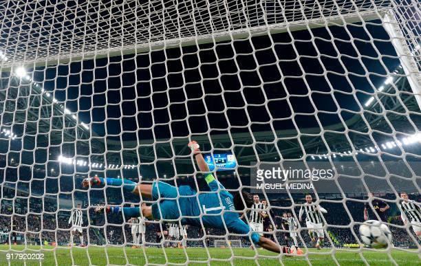 Juventus' goalkeeper from Italy Gianluigi Buffon fails to stop a goal during the UEFA Champions League round of sixteen first leg football match...