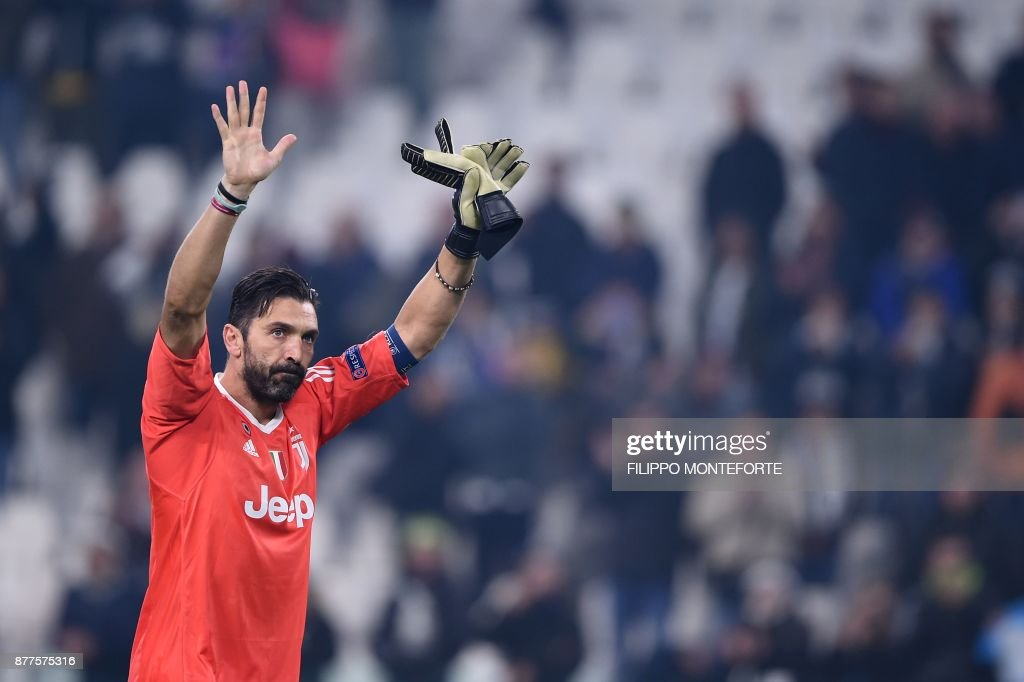 Juventus' goalkeeper from Italy Gianluigi Buffon greets fans at the end of the UEFA Champions League Group D football match Juventus Barcelona on November 22, 2017 at the Juventus stadium in Turin. Barcelona advanced to the Champions League last 16 on Wednesday after clinching top spot in Group D following a 0-0 draw against Juventus in Turin. / AFP PHOTO / Filippo MONTEFORTE