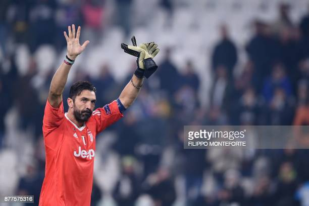 Juventus' goalkeeper from Italy Gianluigi Buffon greets fans at the end of the UEFA Champions League Group D football match Juventus Barcelona on...