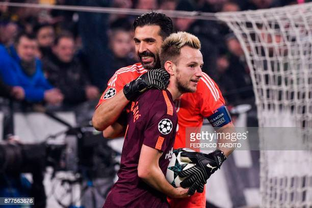 Juventus' goalkeeper from Italy Gianluigi Buffon jokes with Barcelona's Croatian midfielder Ivan Rakitic during the UEFA Champions League Group D...