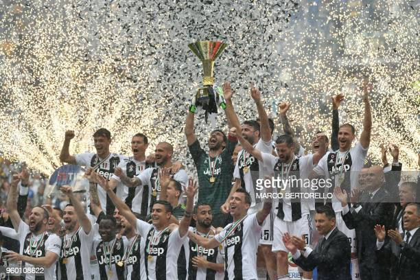 Juventus' goalkeeper from Italy Gianluigi Buffon lifts the trophy during the victory ceremony following the Italian Serie A last football match of...