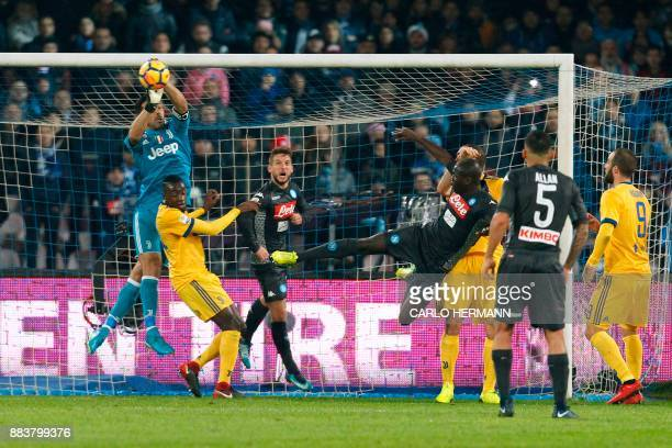 Juventus' goalkeeper from Italy Gianluigi Buffon makes a save next to Juventus' midfielder from France Blaise Matuidi Napoli's forward from Belgium...