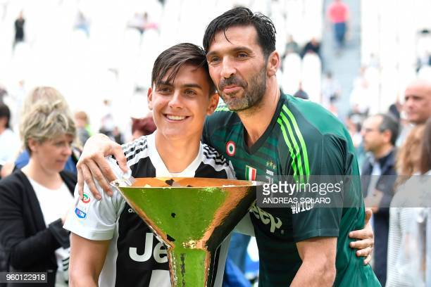 Juventus' goalkeeper from Italy Gianluigi Buffon poses with teammate Juventus' forward from Argentina Paulo Dybala during the victory ceremony...