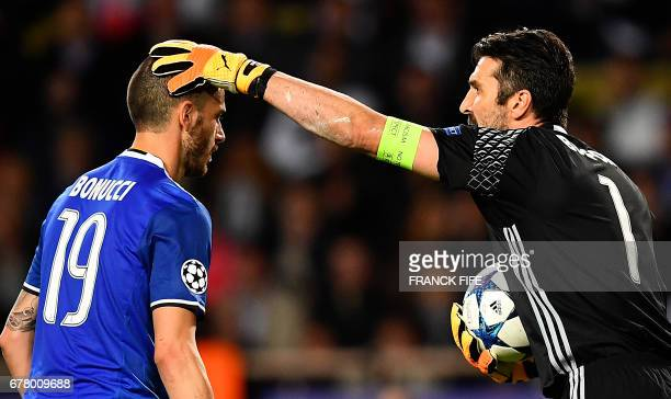 Juventus' goalkeeper from Italy Gianluigi Buffon reacts with Juventus' defender from Italy Leonardo Bonucci after winning against Monaco 20 in the...