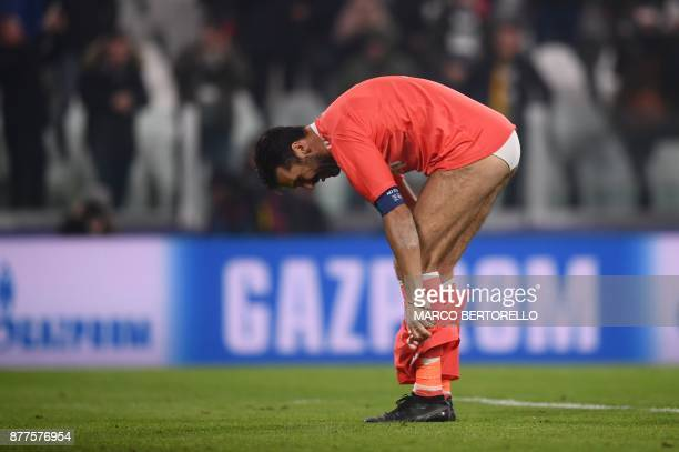 TOPSHOT Juventus' goalkeeper from Italy Gianluigi Buffon takes off his shorts at the end of the UEFA Champions League Group D football match Juventus...