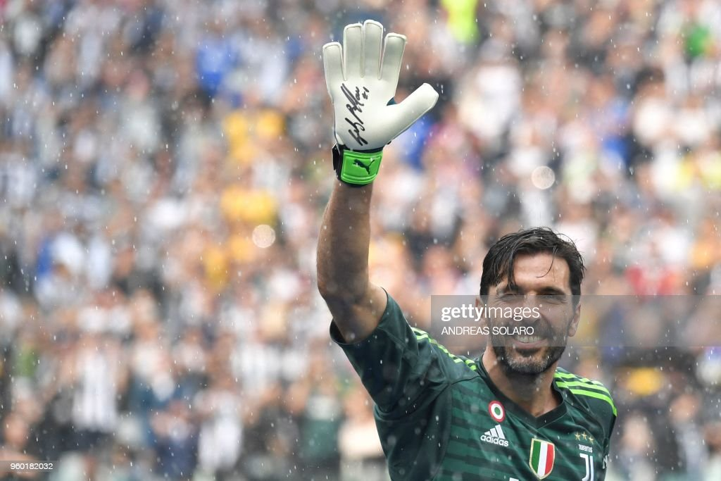 Juventus' goalkeeper from Italy Gianluigi Buffon waves during the victory ceremony following the Italian Serie A last football match of the season Juventus versus Verona, on May 19, 2018 at the Allianz Stadium in Turin. Juventus won their 34th Serie A title (scudetto) and seventh in succession.