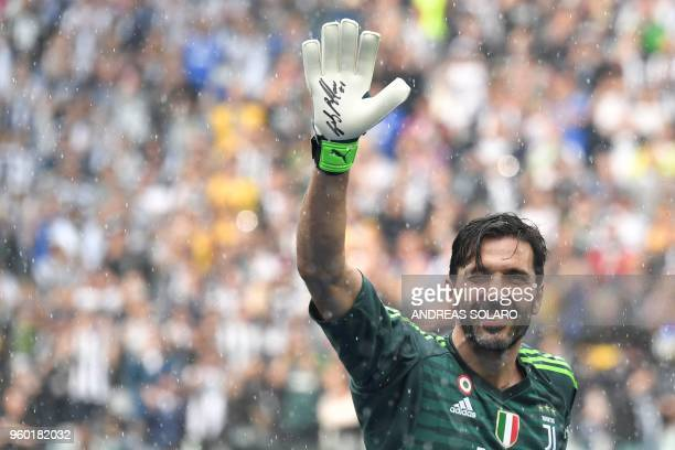 Juventus' goalkeeper from Italy Gianluigi Buffon waves during the victory ceremony following the Italian Serie A last football match of the season...