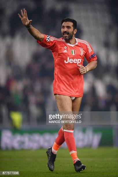TOPSHOT Juventus' goalkeeper from Italy Gianluigi Buffon waves to fans after he took off his shorts at the end of the UEFA Champions League Group D...