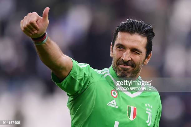 TOPSHOT Juventus' goalkeeper Gianluigi Buffon celebrates at the end of the Italian Serie A football match between Juventus and Sassuolo on February 4...