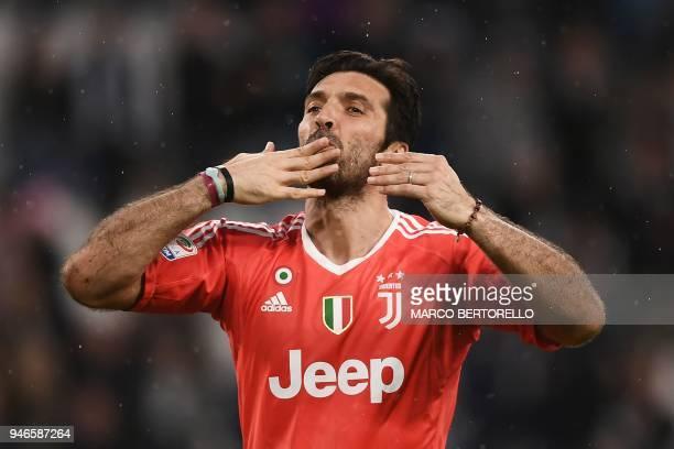 Juventus' goalkeeper Gianluigi Buffon celebrates at the end of the Italian Serie A football match between Juventus and Sampdoria on April 15 2018 at...