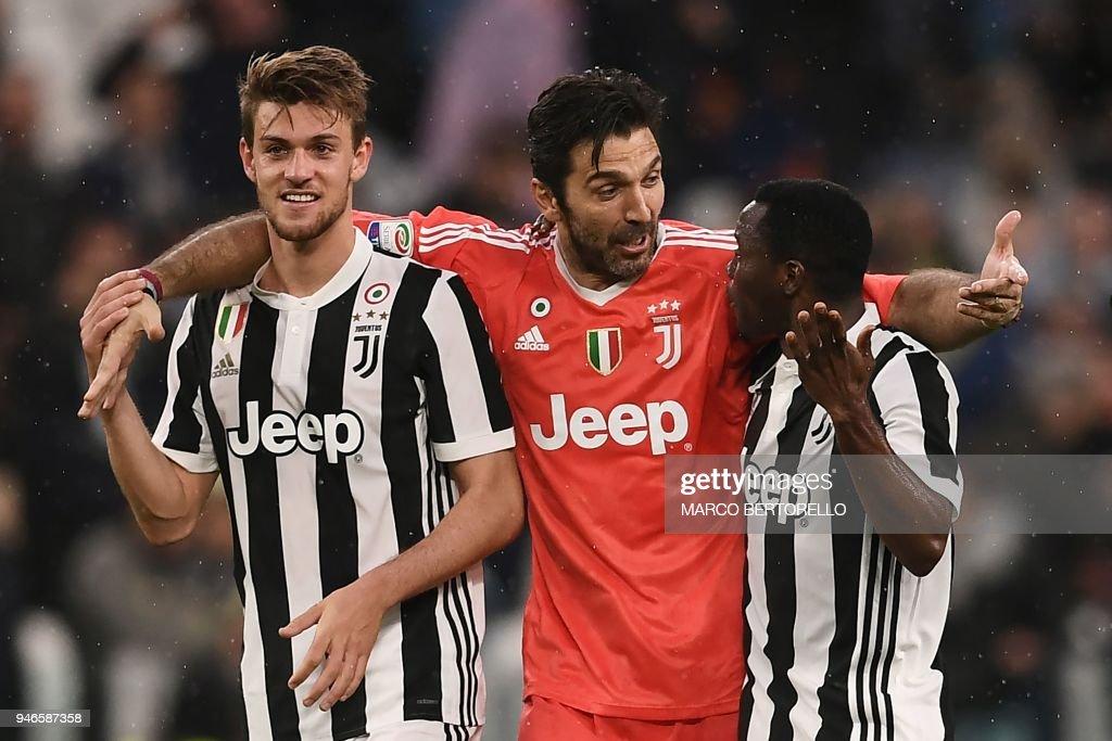 TOPSHOT - Juventus' goalkeeper Gianluigi Buffon (C) celebrates with Juventus' defender Daniele Rugani (L) and Juventus' Ghanaian midfielder Kwadwo Asamoah at the end of the Italian Serie A football match between Juventus and Sampdoria on April 15, 2018 at Allianz Stadium in Turin. Juventus won the match 3-0. /