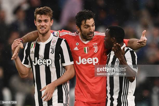 TOPSHOT Juventus' goalkeeper Gianluigi Buffon celebrates with Juventus' defender Daniele Rugani and Juventus' Ghanaian midfielder Kwadwo Asamoah at...