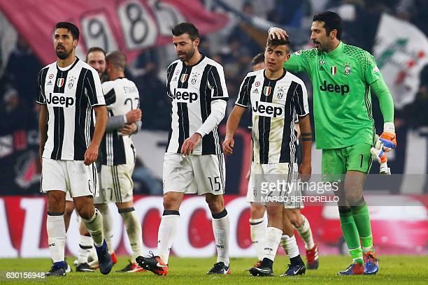 Juventus' goalkeeper Gianluigi Buffon celebrates with Juventus' forward Paulo Dybala of Argentina at the end of the Italian Serie A football match...