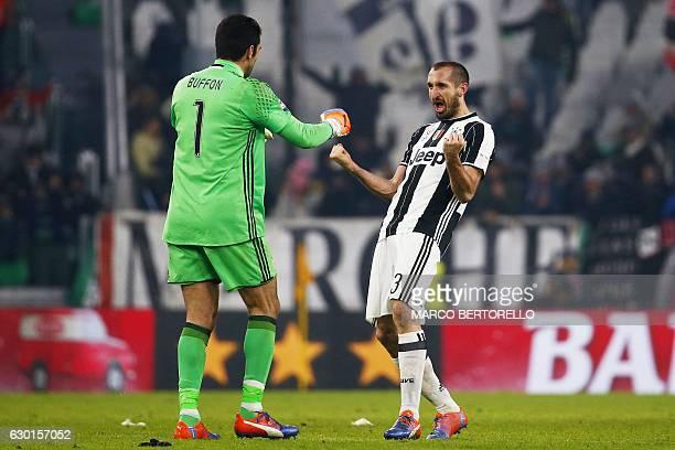 Juventus' goalkeeper Gianluigi Buffon celebrates with Juventus' defender Giorgio Chellini during the Italian Serie A football match Juventus vs As...