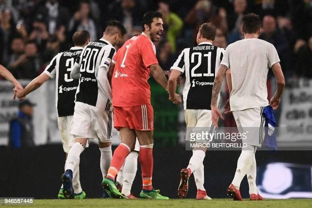 Juventus' goalkeeper Gianluigi Buffon celebrates with teammates at the end of the Italian Serie A football match between Juventus and Sampdoria on...