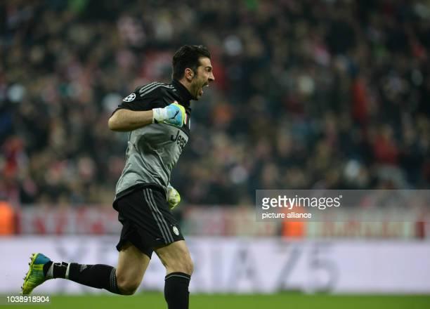 Juventus' goalkeeper Gianluigi Buffon celebrating Cuadrados 20 goal during the Champions League Last Sixteen Knockout Round Second Leg soccer match...