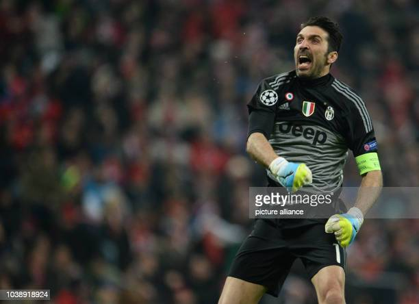 Juventus' goalkeeper Gianluigi Buffon celebrating Paul Pogba's 10 goal during the Champions League Last Sixteen Knockout Round Second Leg soccer...