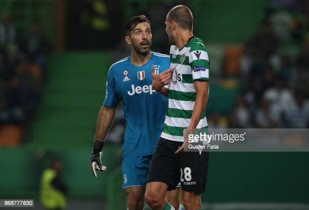 Juventus goalkeeper Gianluigi Buffon from Italy with Sporting CP forward Bas Dost from Holland during the UEFA Champions League match between...