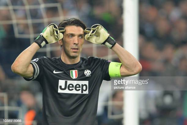 Juventus' goalkeeper Gianluigi Buffon gestures during the UEFA Champions League quarter final second leg soccer match between Juventus Turin and FC...