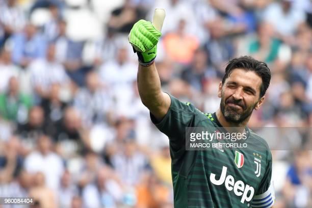 TOPSHOT Juventus' goalkeeper Gianluigi Buffon greets fans during the Italian Serie A football match Juventus versus Verona on May 19 2018 at the...