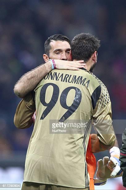 Juventus goalkeeper Gianluigi Buffon hugs Milan goalkeeper Gianluigi Donnarumma after the Serie A football match n.9 MILAN - JUVENTUS on at the...