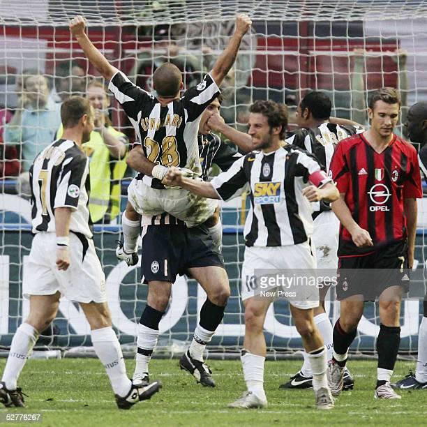 Juventus goalkeeper Gianluigi Buffon hugs teammate Fabio Cannavaro after the Serie A match between AC Milan and Juventus played at the Guisseppe...