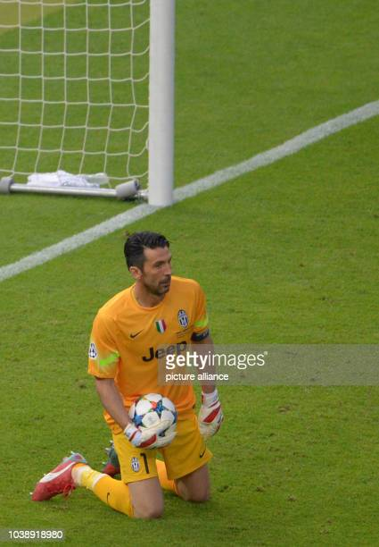 Juventus' goalkeeper Gianluigi Buffon kneels on the pitch during the UEFA Champions League final soccer match between Juventus FC and FC Barcelona at...