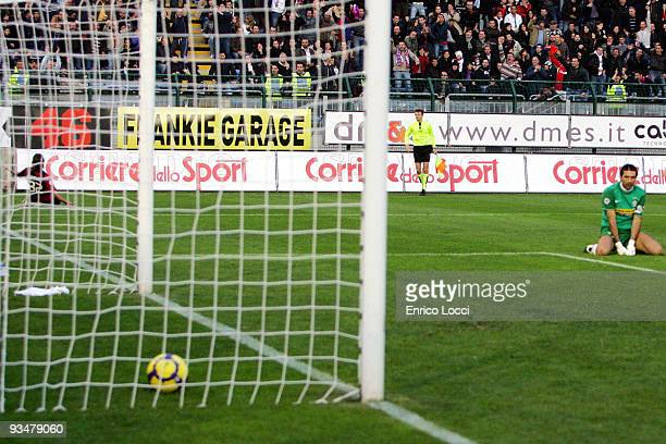 Juventus goalkeeper Gianluigi Buffon looks back at the goal while Alessandro Matri of Cagliari celebrates after scoring the 2:0 goal during the Serie...