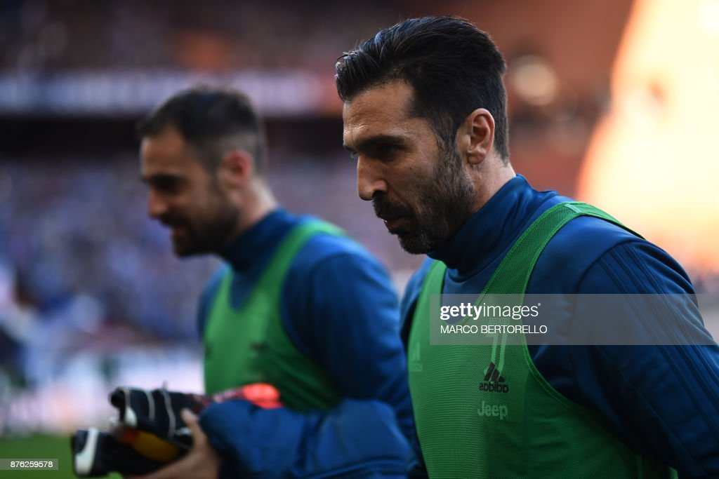 Juventus' goalkeeper Gianluigi Buffon (R) looks on before the Italian Serie A football match Sampdoria Vs Juventus on November 19, 2017 at the 'Luigi Ferraris' Stadium in Genoa. Sampdoria won 3-2. /