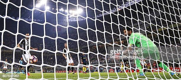 Juventus' goalkeeper Gianluigi Buffon looks the goal of Inter Milan's forward Ivan Perisic from Croatia during the Italian Serie A football match...