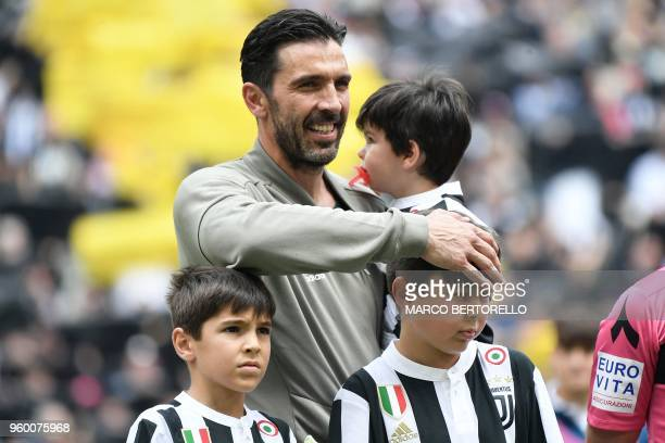 Juventus' goalkeeper Gianluigi Buffon poses with his son before the Italian Serie A football match Juventus versus Verona on May 19 2018 at the...