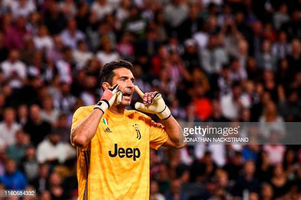 TOPSHOT Juventus' goalkeeper Gianluigi Buffon reacts during the International Champions Cup football match between Atletico Madrid v Juventus on...