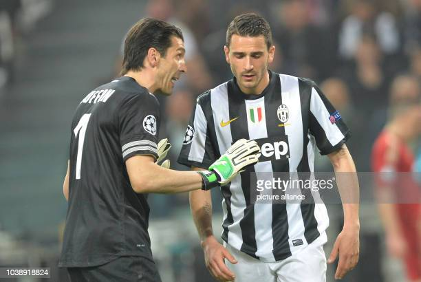 Juventus' goalkeeper Gianluigi Buffon talks to his teammate Leonardo Bonucci during the UEFA Champions League quarter final second leg soccer match...