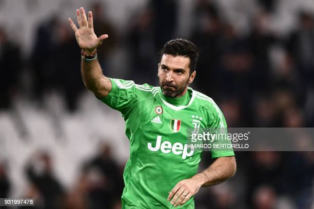 Juventus' goalkeeper Gianluigi Buffon waves at the end of the Italian Serie A football match between Juventus and Atalanta on March 14 2018 at the...