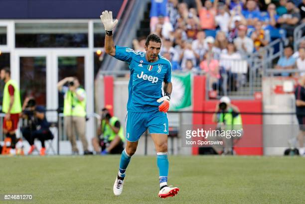 Juventus goalkeeper Gianluigi Buffon waves to the crowd after being subbed out during an International Champions Cup match between AS Roma and...