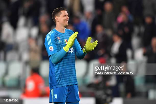 Juventus goalkeeper Wojciech Szczesny celebrates after winning the Serie A match between Juventus and Torino FC on May 3, 2019 in Turin, Italy.