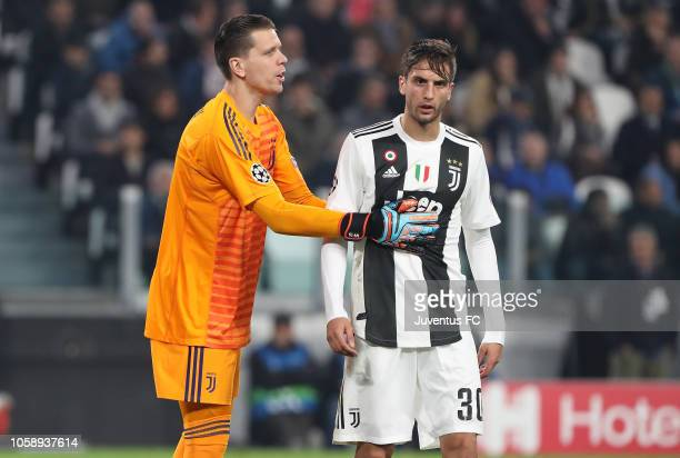 Juventus goalkeeper Wojciech Szczesny encourages his teammate Rodrigo Bentancur during the Group H match of the UEFA Champions League between...
