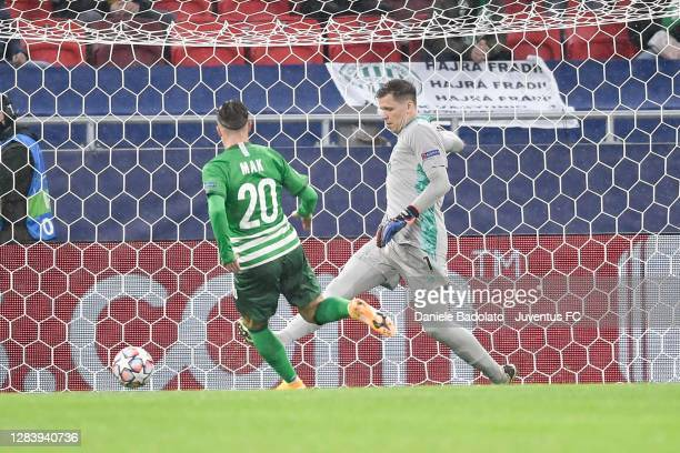Juventus' goalkeeper Wojciech Szczesny in action with Robert Mak of Ferencvaros Budapest during the UEFA Champions League Group G stage match between...