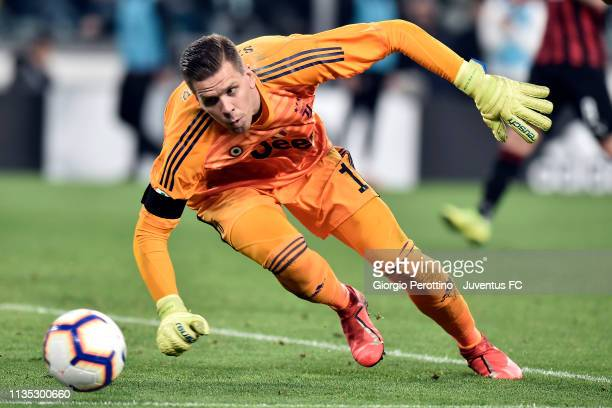 Juventus goalkeeper Wojciech Szczesny saves the ball during the Serie A match between Juventus and AC Milan on April 6 2019 in Turin Italy