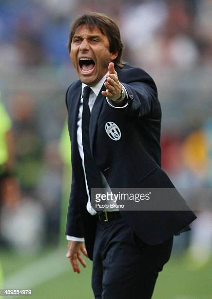 Juventus head coach Antonio Conte reacts during the Serie A match between AS Roma and Juventus at Stadio Olimpico on May 11 2014 in Rome Italy